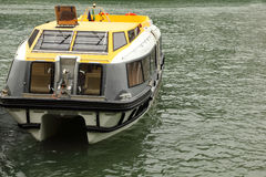 Lifeboat with roof and windows floats at reservoir Royalty Free Stock Photography
