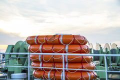 Lifeboat round lifesaver stacked for boat safety Stock Images