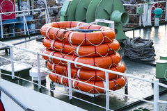 Lifeboat round lifesaver stacked for boat safety Stock Photography