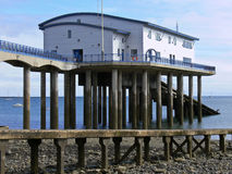 Lifeboat shed. Boat-shed for lifeboat high up at the end of a pier Stock Photo