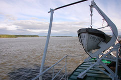 Lifeboat on ship at Kolyma river outback Russia Royalty Free Stock Images