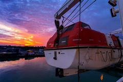 A lifeboat at sunset. With beautiful colors stock image