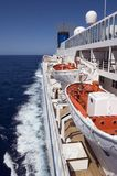 LifeBoats. Cruise ship underway, showing lifeboats Royalty Free Stock Photos