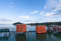 Lifeboats on board the ferry on a background of blue sky. Stock Images
