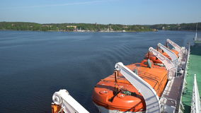 Lifeboats on board a large sea ferry. stock video