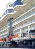 Lifeboats on cruise ship. View of orange lifeboats on the side of a large cruise ship in port royalty free stock image