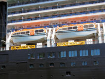 Lifeboats. Enclosed lifeboats on cruise ship Royalty Free Stock Photo