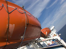 Lifeboats on ferry. Closeup of shipboard lifeboats on ferry at sea Royalty Free Stock Photo