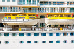 Lifeboats on huge cruise moored, Scandinavia Royalty Free Stock Images