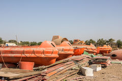Lifeboats for sale at Alang. Lifeboats are for sale in a shop  at the Alang ship recicling place Royalty Free Stock Photo