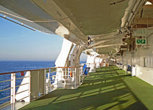 Lifeboats and tender boats on a ship. Lifeboats and tender boats on the outdoor deck on a ship Stock Photo