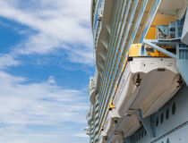 Lifeboats Under Balconies and Nce Sky Stock Photo