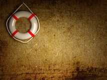 Lifebouys on wall Stock Photography