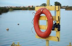 Lifebuoy и пол-стекло в порте Стоковые Изображения RF