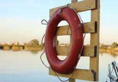 Lifebuoy на доске в порте Стоковые Фотографии RF