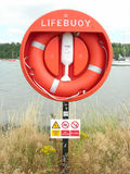 Lifebuoy. Lifebouy at side of river for emergencies Royalty Free Stock Photos