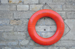 Lifebuoy. Attached to a stone wall Stock Images