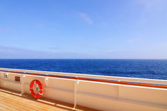 Lifebuoy. Red lifebuoy on a railing of cruise ship royalty free stock photography