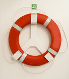 Lifebuoy. Red  lifebuoy on board the passenger ship Royalty Free Stock Photos