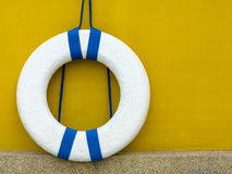 Lifebuoy. Old lifebuoy are hanging on yellow wall royalty free stock images