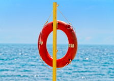 Lifebuoy against sea horison Royalty Free Stock Photo