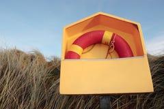 Lifebuoy Among Wild Grass Stock Images