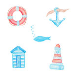 Lifebuoy, anchor, fish, beach changing room and lighthouse Stock Photos