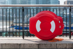 Lifebuoy attached to metal railing Stock Images