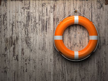 Lifebuoy attached to a wooden wall stock illustration