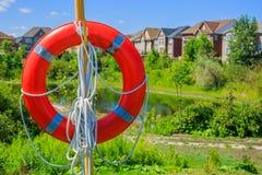 Lifebuoy on a background of luxury houses Stock Photo
