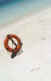A lifebuoy on the beach Royalty Free Stock Image