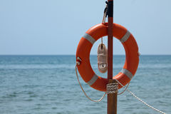 Lifebuoy on the beach Royalty Free Stock Photos