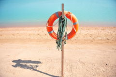 Lifebuoy on beach Stock Photography