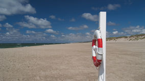 Lifebuoy on beach Royalty Free Stock Photography