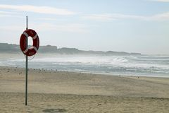 Lifebuoy on beach Stock Photo