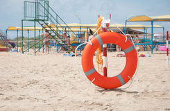 Lifebuoy on a beach Royalty Free Stock Image