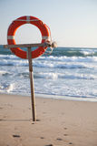 Lifebuoy on a beach. Of the sea Royalty Free Stock Photo