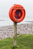 Lifebuoy. A Lifebuoy on a beach Royalty Free Stock Photo