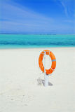 Lifebuoy and beach Royalty Free Stock Photo
