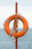 Lifebuoy on the beach. Background Stock Photography