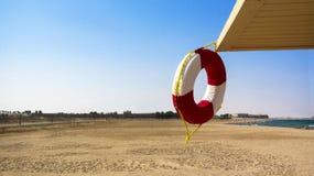 Lifebuoy on the beach Stock Photo