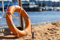 Lifebuoy on beach Royalty Free Stock Image