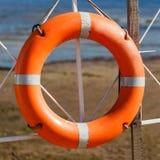 Lifebuoy on beach Stock Photos