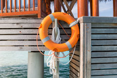 Lifebuoy on beach patio or terrace in sea water Stock Photos