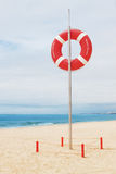 Lifebuoy on a beach in Portugal. Stock Photos