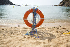 Lifebuoy on a beach. Red lifebuoy on a beach Stock Images