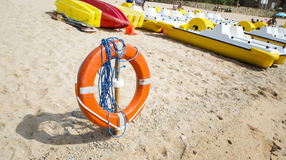 Lifebuoy on a beach. Red lifebuoy on a beach Stock Image