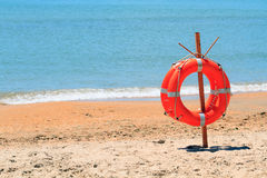 Lifebuoy on a beach Stock Photography