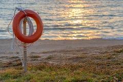 Lifebuoy on beach Royalty Free Stock Photos