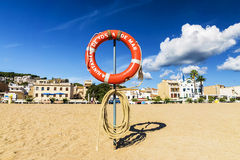 Lifebuoy on the beach in Tossa de Mar, Spain. an inscription on. A circle in Catalan: Tossa de Mar Stock Images